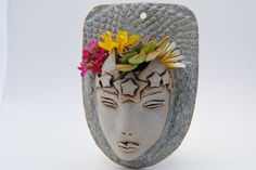 ceramic face planter garden art mask wall planter head planter. $28.00, via Etsy.
