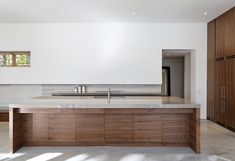 Glossy Marble Countertop on Wood Kitchen Island in Carling Residence Modern Ceiling Lights Wood Cabinet Clean Marble Floor Kitchen Interior, Kitchen Design, Minimal Kitchen, Stylish Kitchen, Style Deco, Wooden Kitchen, Stone Kitchen, Glass Kitchen, Cuisines Design