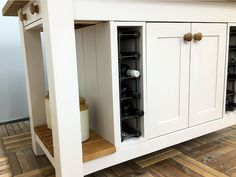 Useful storage & display are combined in this island design. It incorporates a double cupboard flanked by wine storage racks, 2 end cutlery drawers, an oak slatted display shelf plus a long breakfast bar along one side. Shown here finished in Farrow & Ball Peignoir Estate Eggshell finish & in an overll size of L:1600mm D:900mm H:910mm but any size or colour is available to order. Painted Kitchen Island, Kitchen Islands, Wine Rack Storage, Tall Cabinet Storage, Freestanding Kitchen, Island Design, Eggshell, Farrow Ball, Display Shelves