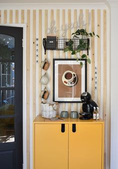 diy coffee station after shot with yellow cabinet and wooden wall panelling Wire Basket Storage, Basket Shelves, Coffee Cup Set, My Coffee, Coffee Corner, Diy Projects On A Budget, Yellow Cabinets, Coffee Supplies, Pretty Mugs