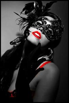 Women in masks having sex