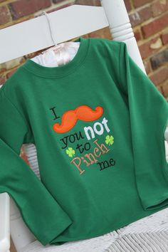 St. Patrick's Day Shirt for Boys -- mustache onesie or shirt -- I Mustache you not to pinch me -- leprechaun mustache. $ 26.00, via Etsy.