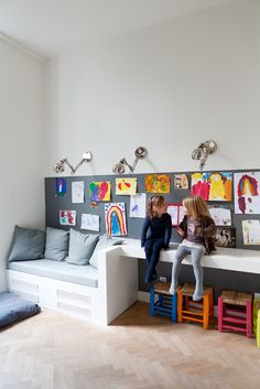 Little bit of seating, little bit of desk. Great idea for a wall of the playroom.