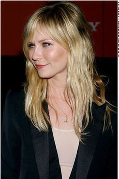 kirsten dunst- curtain bangs