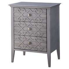 """• Super-stylish, raised fretwork pattern<br>• Vibrant, painted finish<br>• Sturdy, hardwood construction<br>• 3 drawers with brushed metal pulls<br>• Dimensions: 23.5"""" H x 18"""" W x 15"""" D<br><br>The Threshold, Fretwork Accent Table is the best of on-trend style and solid design. This wood accent table has 3 drawers for storage and works great as a side table or end table.  Its super-fun fretwork desi..."""