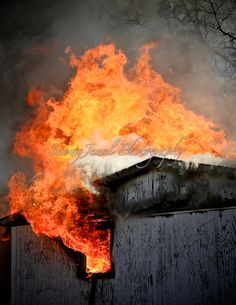 This amazing photo of a burning house was taken in 2014 during a training event for a volunteer fire department in Alabama.  The house was abandoned and unsafe to live in, and the town donated it to the local fire dept. to be used for training on house fires. All personnel involved in the training event stayed safe, and burned the house down carefully.  This particular shot is of the thick flames and smoke billowing out of the roof, and blocking out the sunlight above.  The photo is cropped…