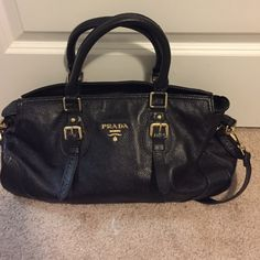 Black Prada bag This shiny leather black Prada bag, comes with shoulder strap to add and carry as cross over or carry as handbag. Prada Bags Shoulder Bags