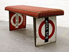 a new bench made from decommissioned London bus stop signs with upholstered Routemaster  bus seat fabric by Rupert Blanchard #bench #London