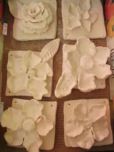 "ceramic sculptures; approx. 7"" X 7"" (bisque ware); lesson by art teacher: Susan Joe"