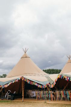 Image by Babb Photo - A rustic wedding with a tipi reception venue with the bride in an embellished dress and groom in a blue suit. Handmade wedding favours and tassel garlands. Photography by Laura Babb. Tipi Wedding, Marquee Wedding, Farm Wedding, Rustic Wedding, Wedding Venues, Wedding Ideas, Wedding Gowns, Wedding Table, Destination Wedding