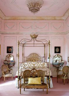 Opulent pink bedroom with gilded furniture & stenciled walls