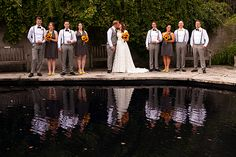 I have a photo I'm obsessing over from  a wedding at the Arboretum in Guelph, ON! This is still one of my favourite bridal party photos as there was a pond just below them-hello mirrored reflections! The girls were wearing dark grey dresses contrasted with bright sunflower bouquets.  The guys were wearing matching suspenders and bow ties. I love how the ivy just grows like a weed there, with juxtaposing stone walls and floors.