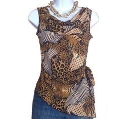 Asymmetrical Sleeveless Animal Print Top PARIS Unusual Made in France top with animal print and gold accents. Stretchy material consisting of 90% polyester and 10% spandex. No size tag but should fit a size medium just fine. Never worn. Lissa Paris Tops