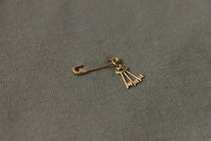 set of keys (from heart, from home and cottage in the woods), tiny charity safety pin brooch, mywhiteroom