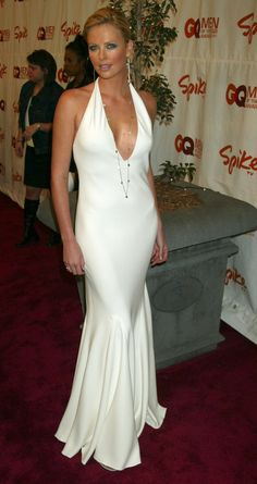 Charlize looked white hot cleavage baring Ralph Lauren gown | How Charlize Theron Has Schooled Us All in Sexiness | POPSUGAR Celebrity Photo 24