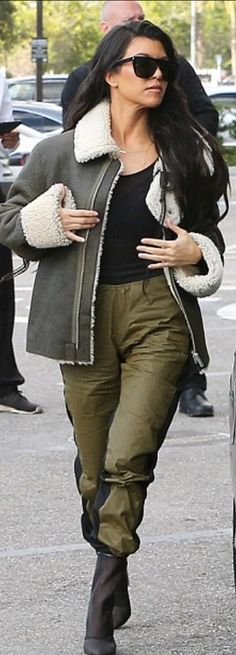 Who made Kourtney Kardashian's ankle mesh boots, black sunglasses, and brown shearling jacket?