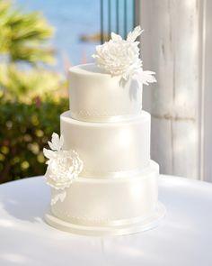 Simple elegant all white wedding cake with sugar peonies