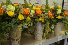 Love the birch vases for a natural, country feel.