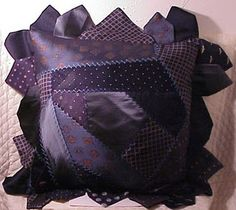 Purple pillow made of neckties [I would far prefer it without the fussy edging]