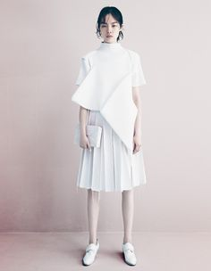 Contemporary Fashion - all white outfit; innovative pattern cutting // Ph. Patrick Demarchelier