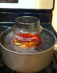 Save your used Scentsy bar containers... When you have a candle that has burned down a lot but still has some wax left, stick it in a pan of boiling water. When the wax melts, pour it into the empty containers. I just did this tonight with my old holiday scented Yankee Candles. I got 4 containers of the Mistletoe scent from just a small amount of wax.