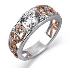 Serenade Collection - This gorgeous 18K white and rose gold ring is comprised of .14ctw round white Diamonds.  - MR2115