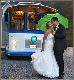 An adorable trolley escorts the couple to their reception. Wedding Photographer: Ciao Bella Celebrations.