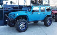 Blue Jeep Wrangler JK on display at SEMA 2014