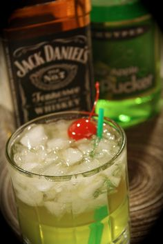 AppleJack ~ 1.5oz Apple Pucker, 1oz Jack Daniels Whiskey, Splash of Sour Mix, Club Soda - Build over ice in a rocks glass adding Jack, sour apple, sour mix then club soda last. Stir that drink and viola!