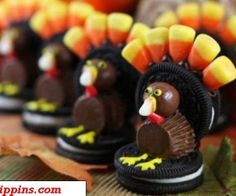 Re-create your own Thanksgiving turkey using candy corn, Reese's Peanut Butter Cups, and Oreos!
