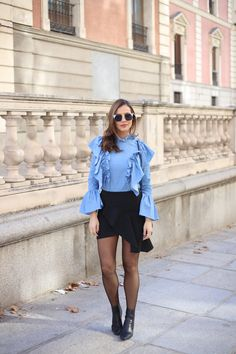 Blue flares looks - Lady Addict. Blue ruffled blouse+black skirt+black tights+black ankle boots+black tassel shoulder bag. Winter Business Casual Outfit 2017