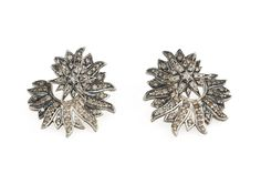 Genesis H.Stern collection. Draco earrings in Noble Gold with diamonds.
