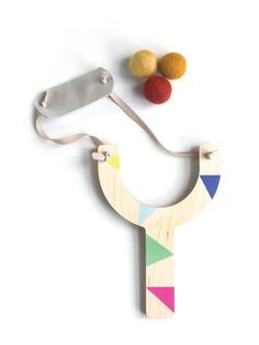 Painted slingshot with felt balls, what a lovely gift this would be!  #estella #kids #gifts #toys