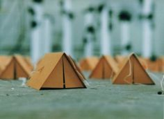 cardboard tents, signs of summer to come. Wouldn't these make fantastic escort cards for a camp themed wedding?