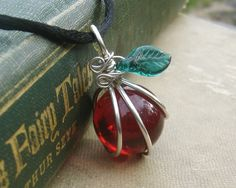 Ruby Red  Apple Glass Pendant - Teacher Gift - Graduation - Sterling Silver Wire Wrapped Necklace. $12.50, via Etsy.