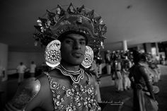 a typical Kandyan dancer awaiting his turn to perform
