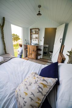 Fenman's hut (a special take on a Shepherd's Hut). Modern rustic. Reclaimed wood floors, dresser from a railway carriage with a zinc top. Farrow and Ball Cabbage White