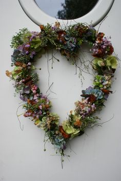 Beautiful, heart-shaped wreath of dried florals and herbs