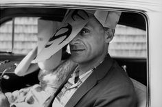 Arthur Miller peers out from behind a paperbag mask by Saul Steinberg (cartoonist) … USA … 1962 … by Inge Morath (1923–2002) … Arthur Asher Miller (1915–2005), American, playwright, essayist, and prominent figure in twentieth-century American theatre, ex-husband to Marilyn Monroe, married photographer Inge Morath in 1962 …
