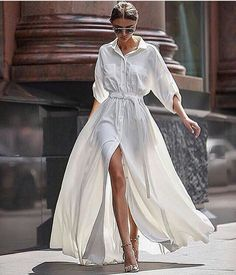 White shirt dress, but with an unbuttoned slit for an untraditional twist