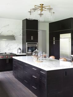 Modern Black Kitchen Cabinets dark cabinets, grey countertops and light wood floors | for the