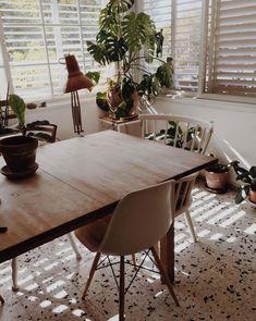 dining area with vintage lighting and terrazzo floors. / sfgirlbybay