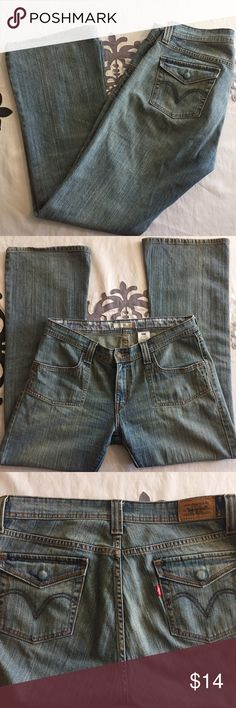 """Levi's low flare 542 size 12M Waist is about 18""""!laid flat. Inseam about 32"""". There is wear in the bottom hem, as shown. Tiny black stain at bottom back of left pant leg. As shown in fourth photo. Levi's Jeans"""