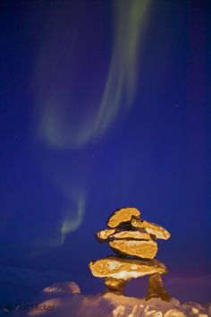Canadian Arctic: The Inukshuk Landmark and the Northern Lights are symbols of the Canadian Arctic. Canadian arctic; Alaska, winter, Northern Lights, Inukshuk.