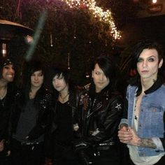 Notice how Andy is the only one with a blue jean jacket while the others are all in black?