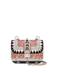 Embrace The Eclectic: @maisonvalentino beaded geometric patch shoulder bag.