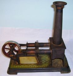 An antique toy hot air engine, made in Germany by Bing. The  base measures approx 8 1/2  x 4 inches.