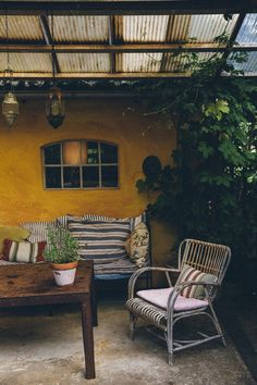 rustic covered patio with rattan chair in sweden. / sfgirlbybay