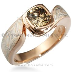 Mokume Swirl Solitaire Engagement Ring - Mokume gently swirls around the center bezel set stone in this solitaire engagement ring. The sensual flow of the design works well with the organic pattern of the mokume. Wear it alone or pair it with a custom contoured wedding band. At the widest point, the band measures 5mm tapering to 3.5mm on the palm side.