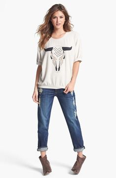 Casual denim look: Rolled jeans  cuffed sweatshirt top with western ankle booties.